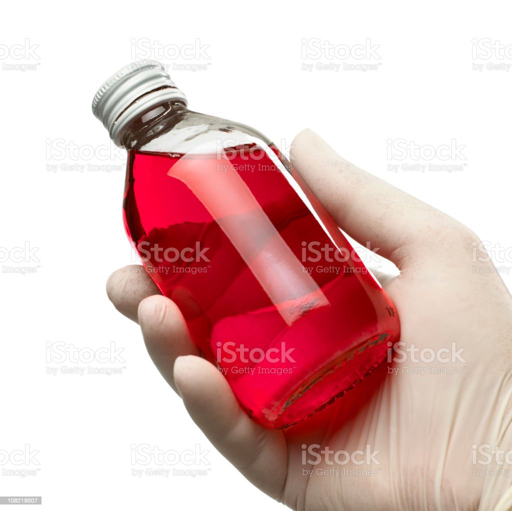 Holding a bottle of cough syrup royalty-free stock photo