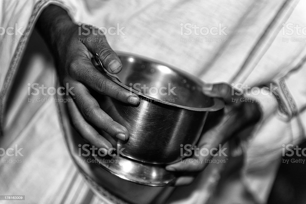 Holding a bowl royalty-free stock photo