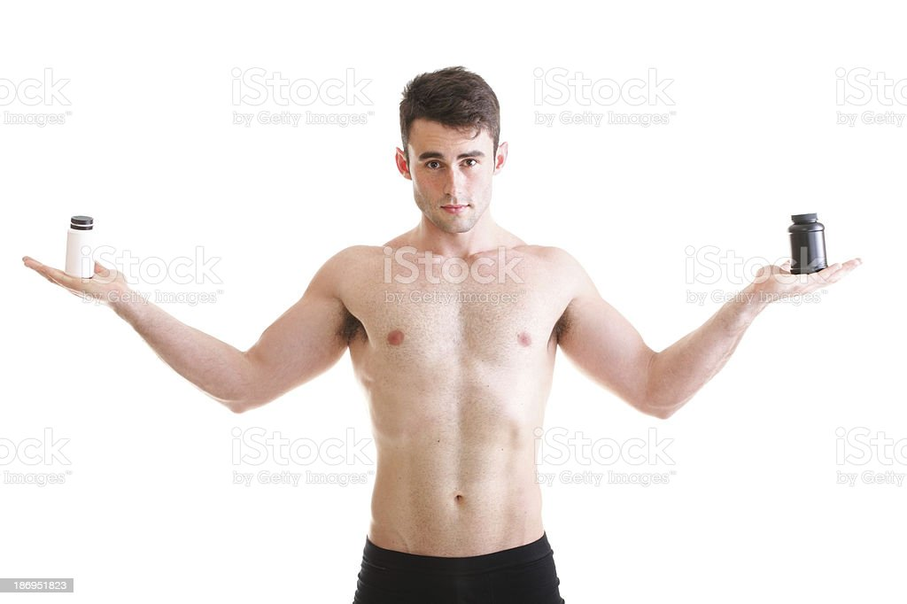 holding a boxes with supplements on his biceps royalty-free stock photo