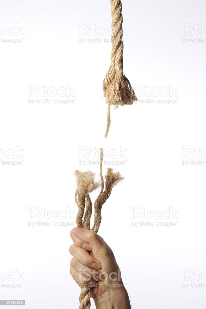 Holding a breaking brown rope against white background royalty-free stock photo