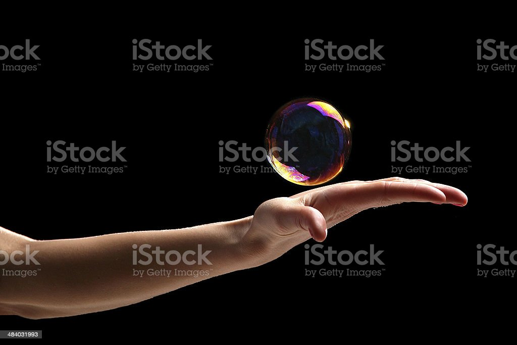 Holding a bubble in hand stock photo