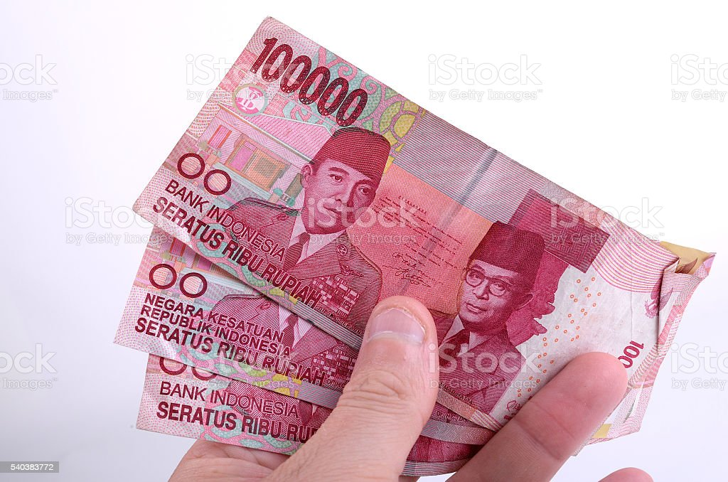 Holding a bunch of Indonesian currency stock photo