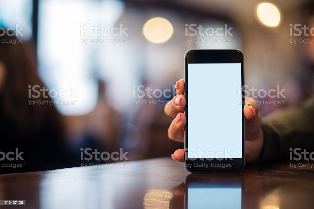 Holding a cellphone stock photo