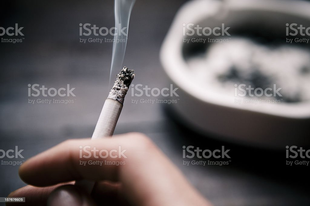 Holding a cigarette. stock photo