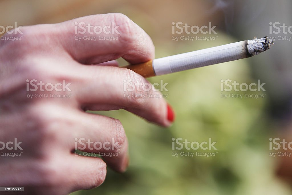 Holding a Cigarette royalty-free stock photo