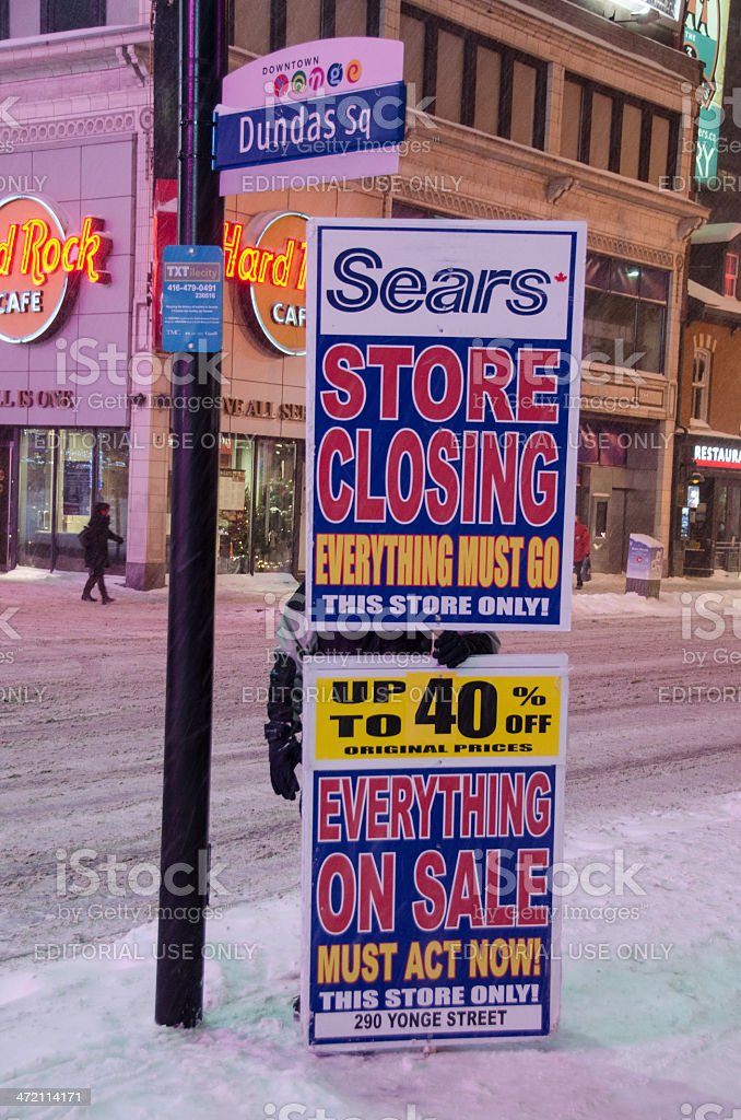 Holding a closing sign for Sears store in Toronto stock photo