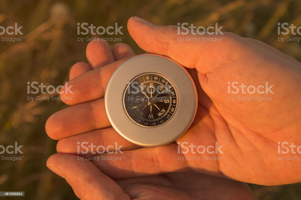 Holding a compass stock photo