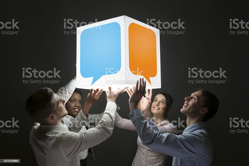 Holding a conversation social networking speech bubbles royalty-free stock photo