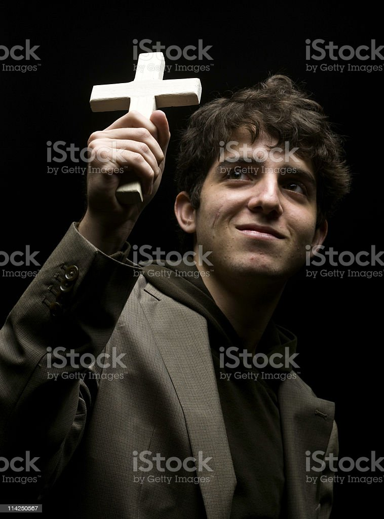 Holding a crucifix stock photo