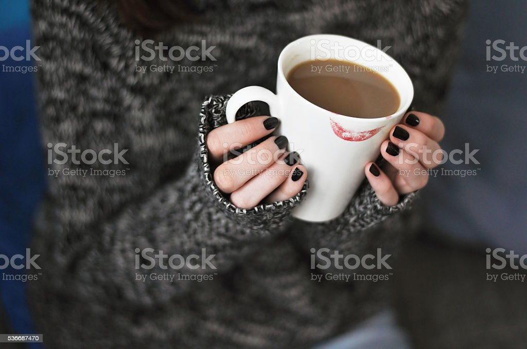 Holding a cup of coffee stock photo