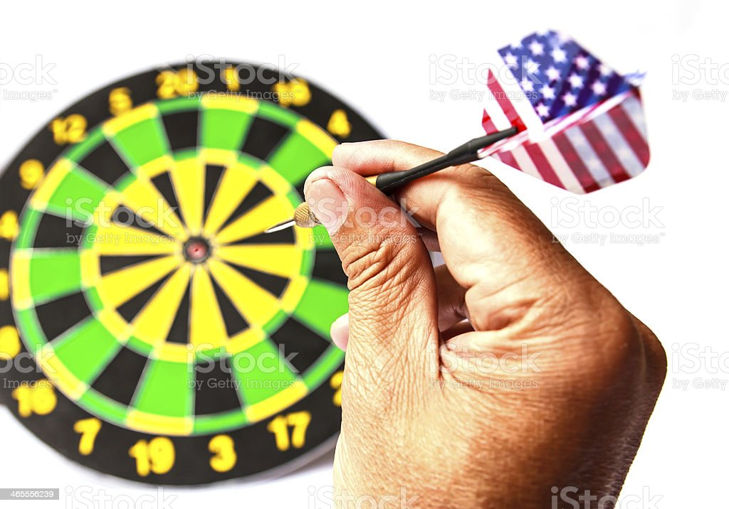 Holding a dart getting ready to aim royalty-free stock photo