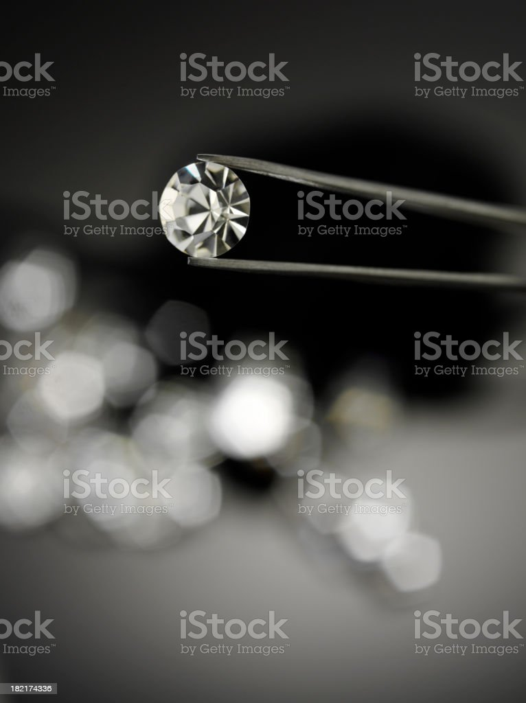 Holding a Diamond with Jewellery Tweezers royalty-free stock photo