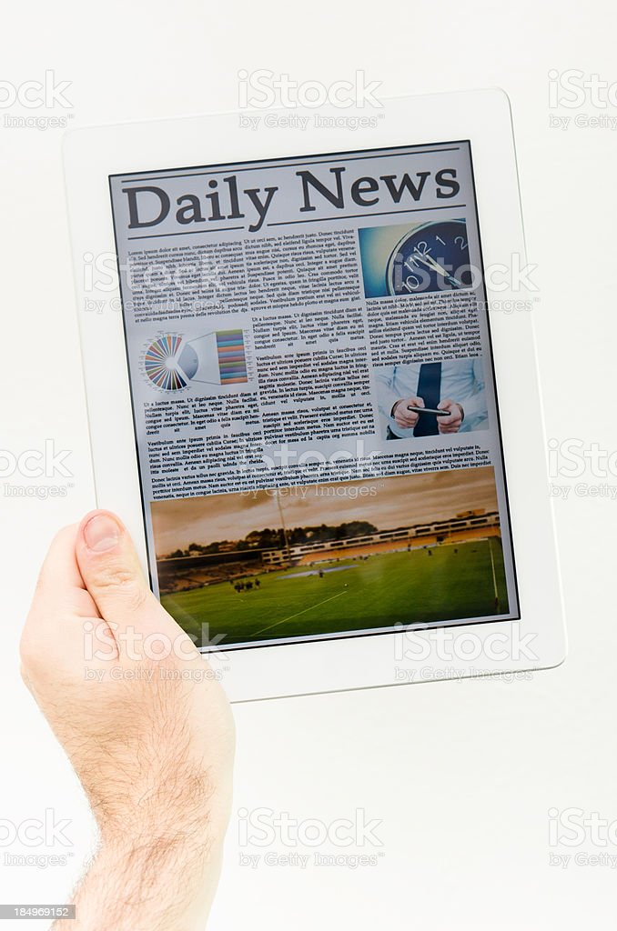 Holding a digital Newspaper on contemporary Tablet royalty-free stock photo