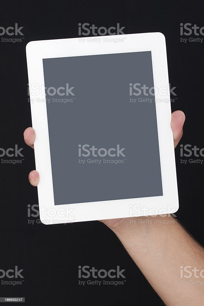 holding a digital tablet royalty-free stock photo
