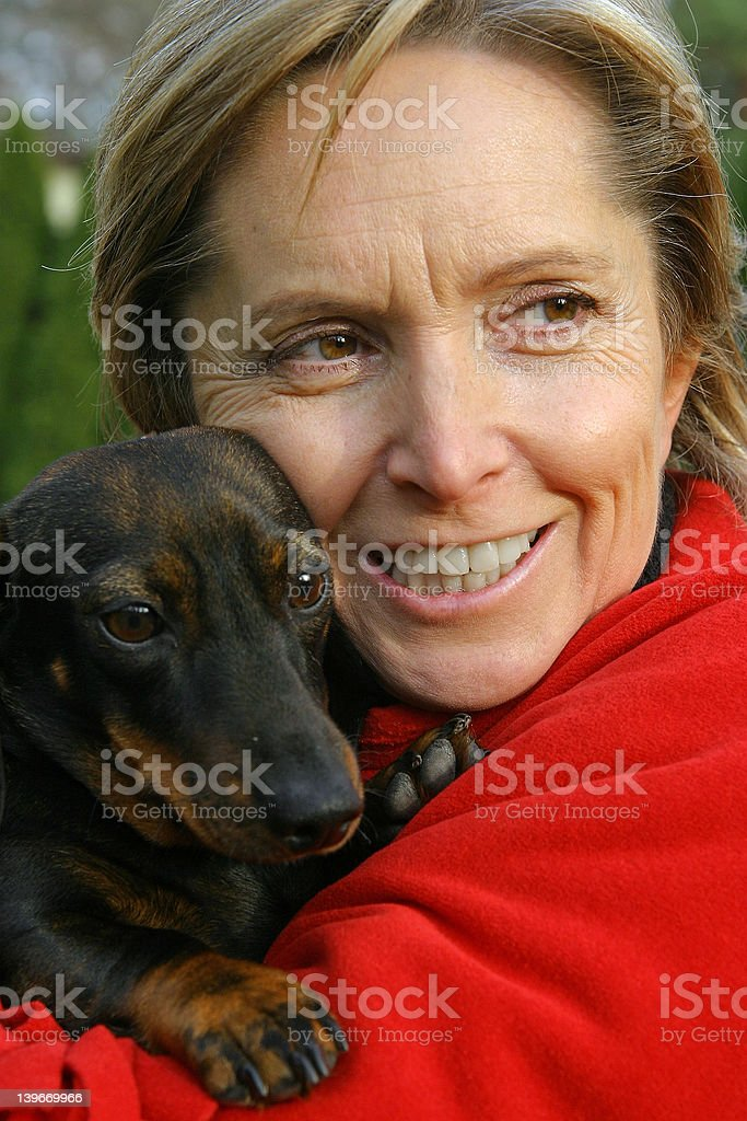 holding a dog royalty-free stock photo
