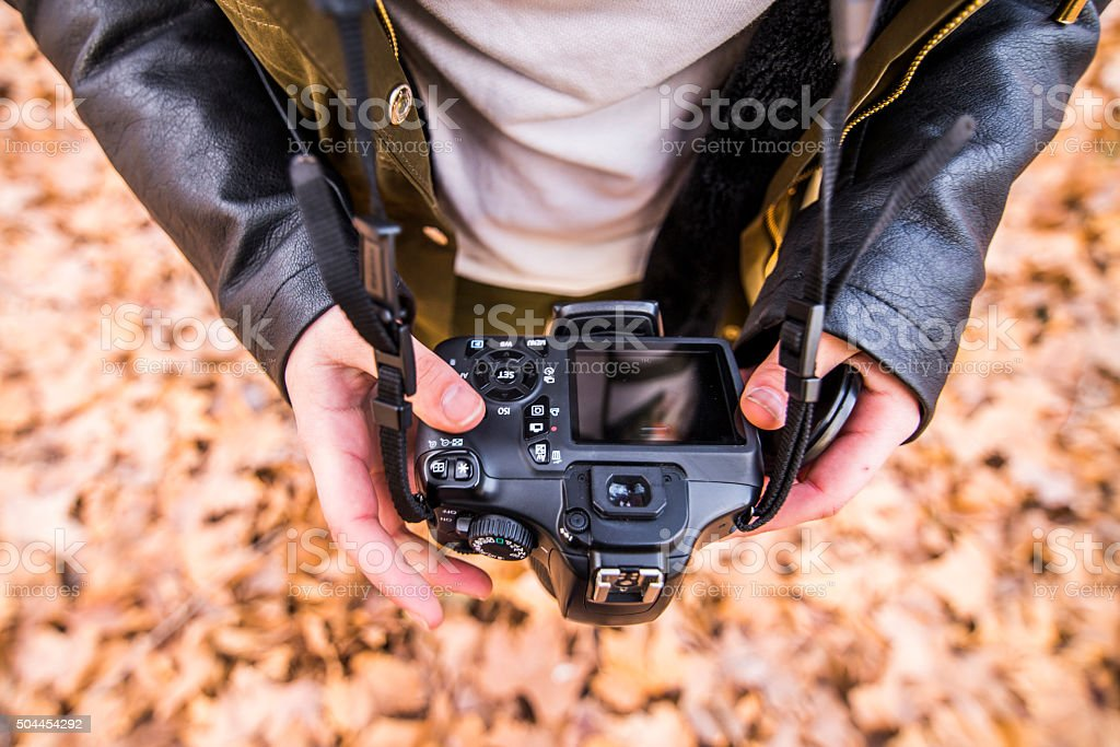 Holding a DSLR camera. stock photo