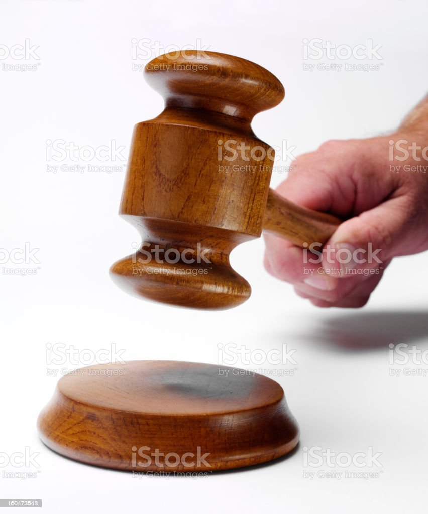 Holding a Gavel royalty-free stock photo