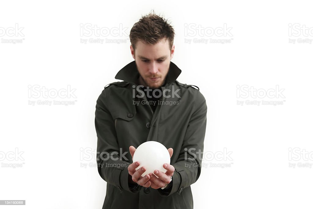 Holding a glass ball royalty-free stock photo