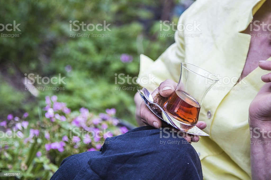 holding a glass of tea royalty-free stock photo