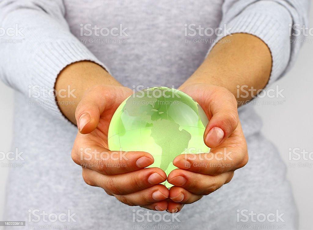 Holding a globe stock photo