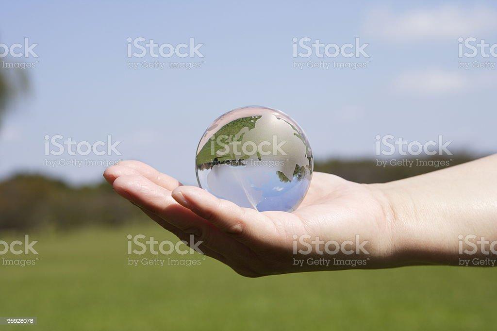 Holding a globe royalty-free stock photo