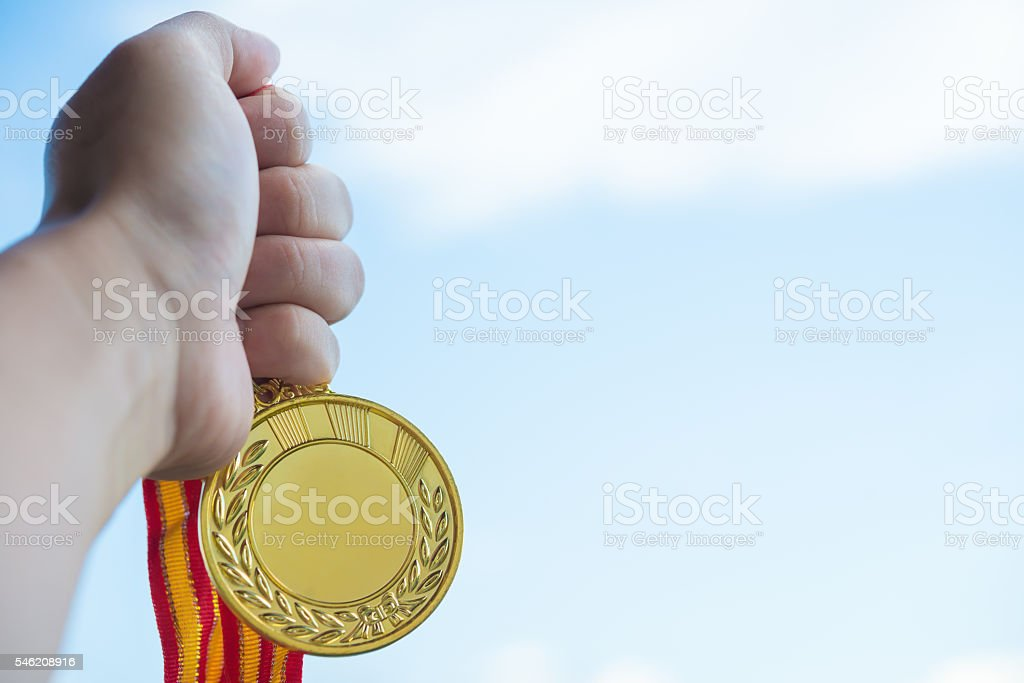 holding a gold medal stock photo