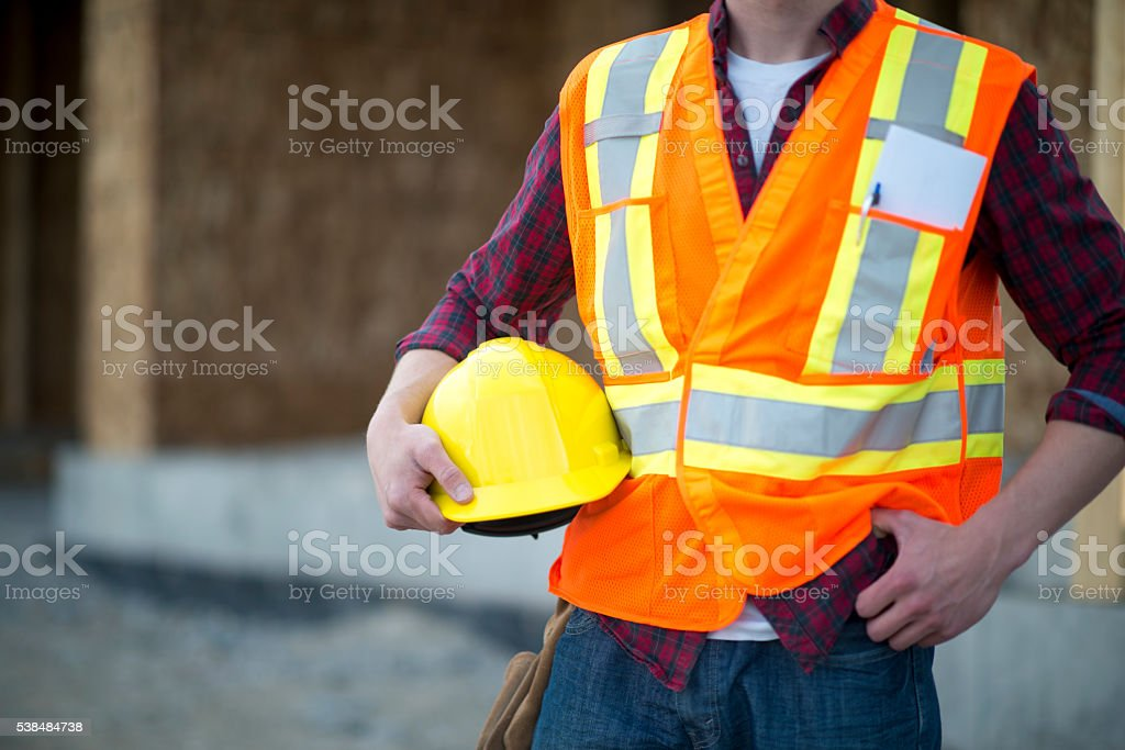 Holding a Hard Hat stock photo