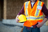 Holding a Hard Hat