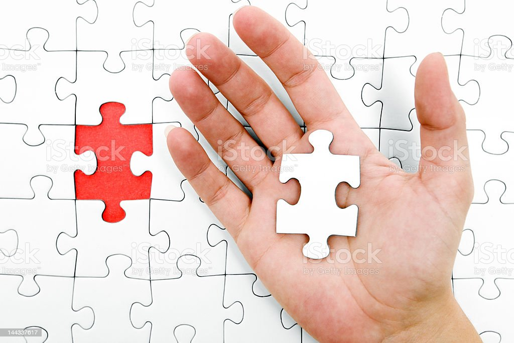 Holding a Jigsaw Piece royalty-free stock photo