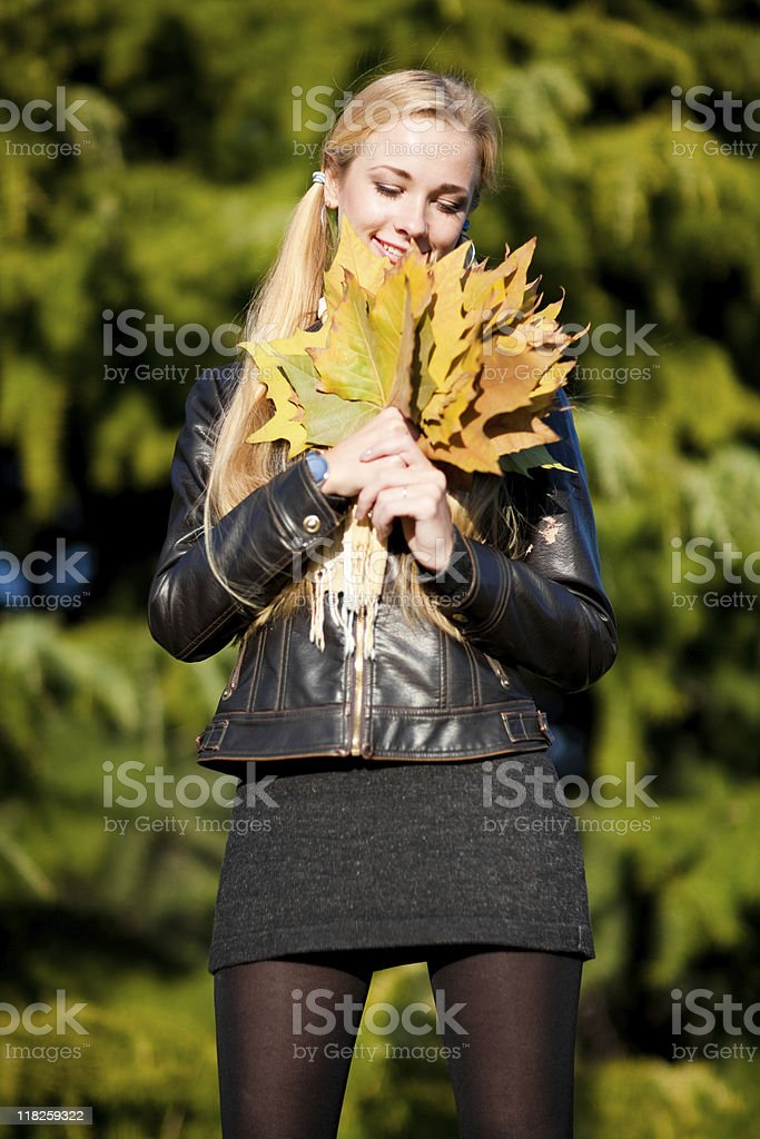 Holding a leaf stock photo