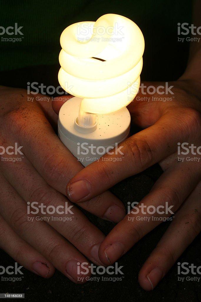 Holding a light bulb stock photo