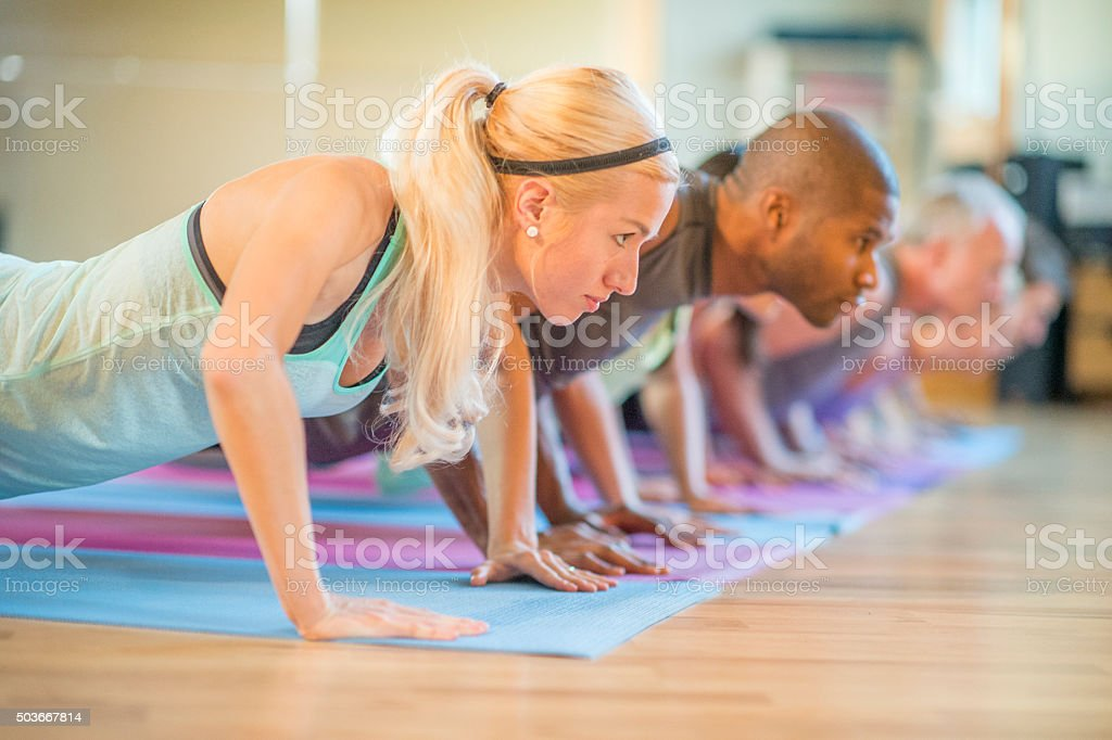 Holding a Low Plank stock photo