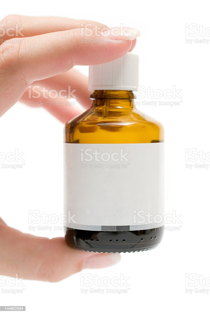 Holding a Medicine Bottle stock photo