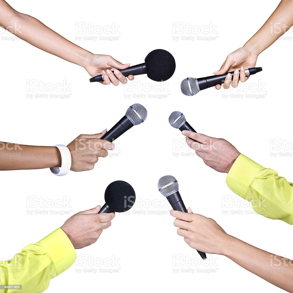 Holding a microphones royalty-free stock photo