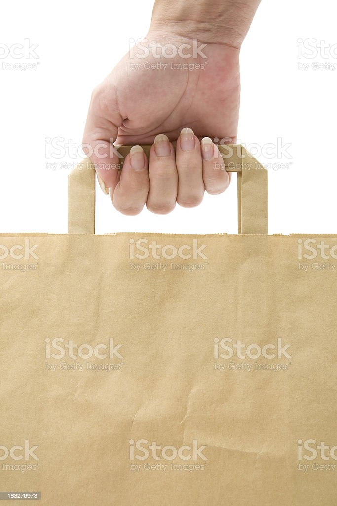 Holding A Paper Shopping Bag stock photo