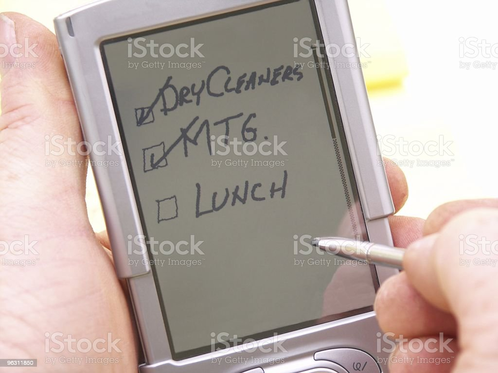 Holding a PDA royalty-free stock photo
