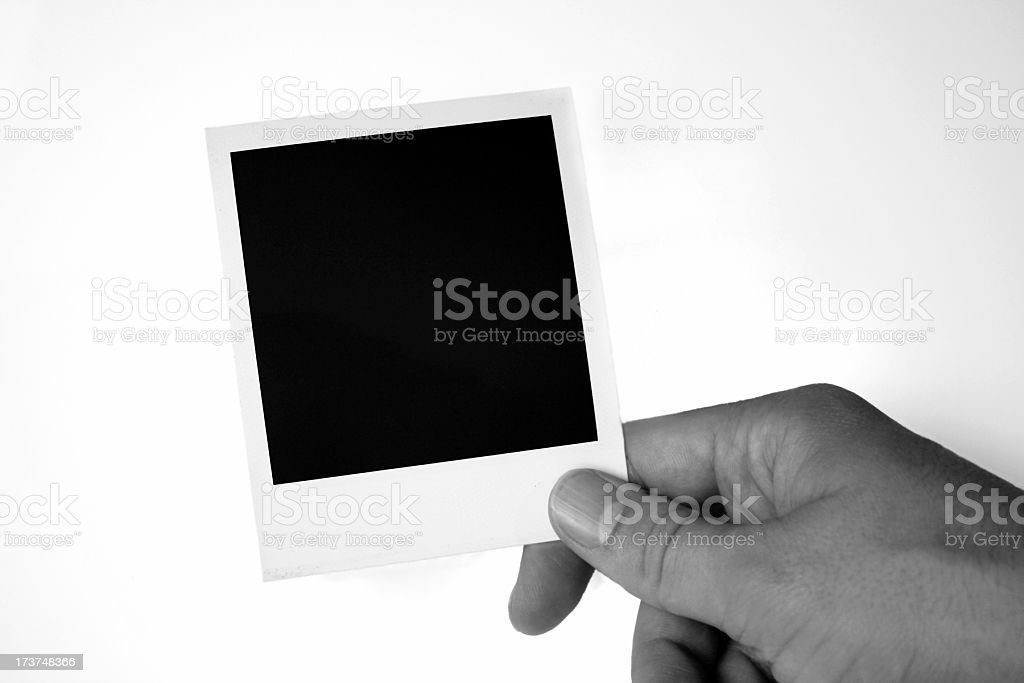 Holding a photo royalty-free stock photo
