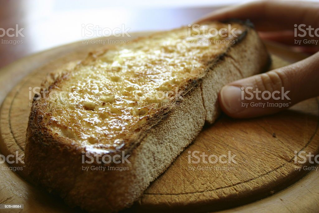 Holding a Piece of Toast royalty-free stock photo