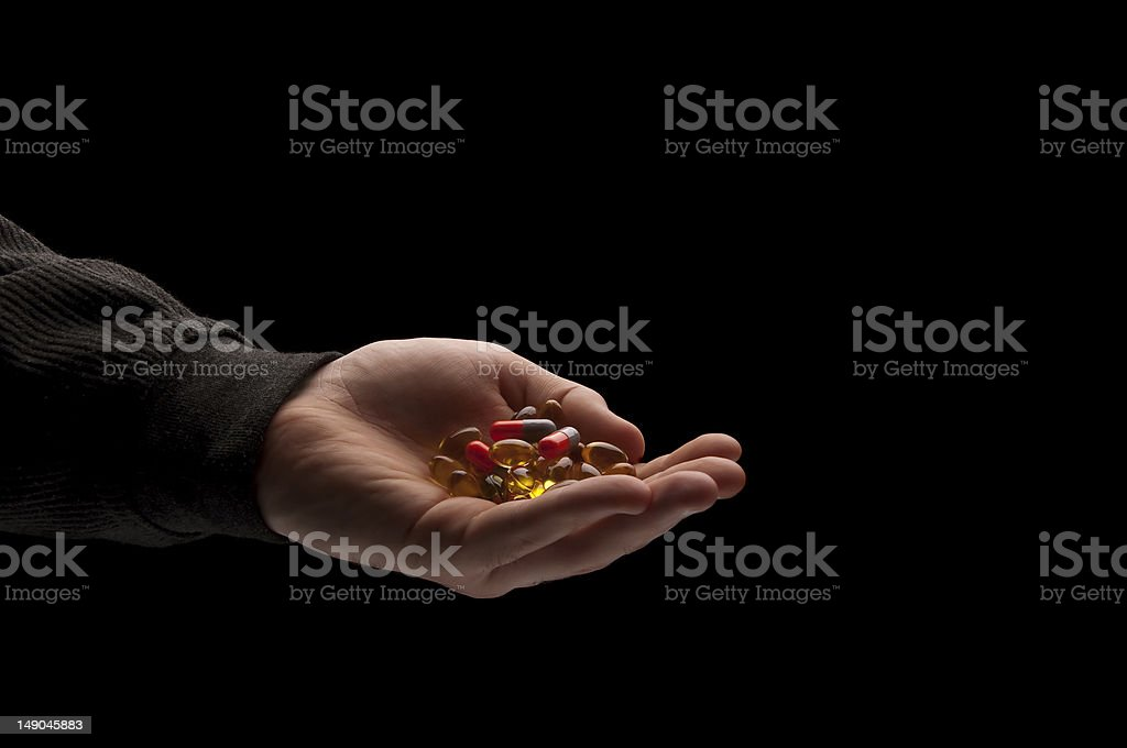 Holding a pills royalty-free stock photo