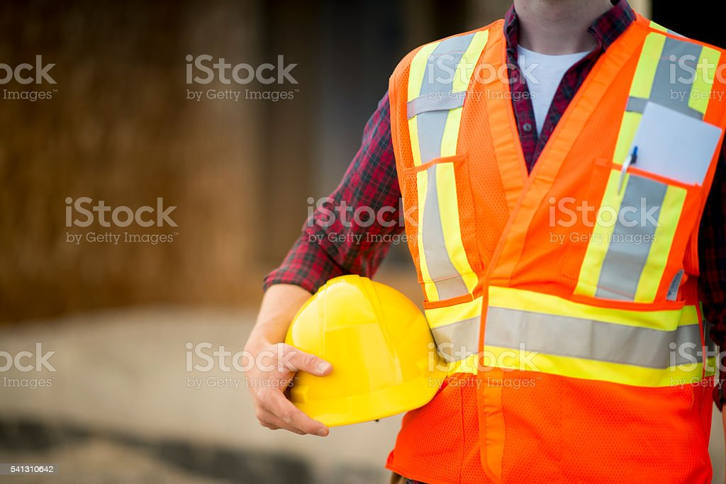 Holding a Safety Helmet stock photo