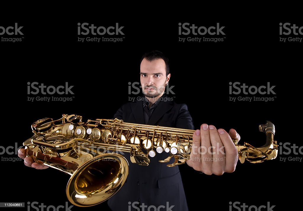 holding a saxophone stock photo
