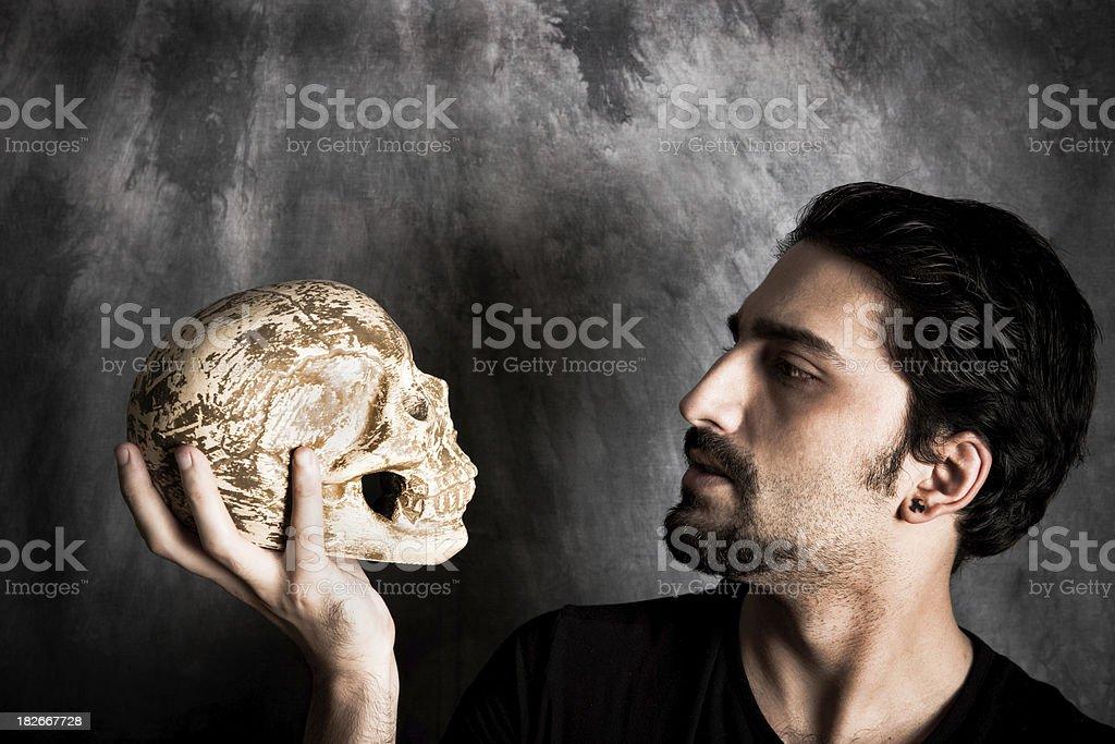 holding a skull stock photo