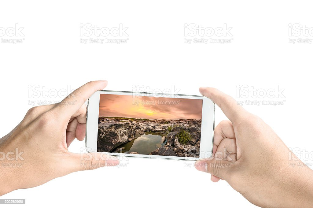 Holding a smart phone ,Take a picture stock photo
