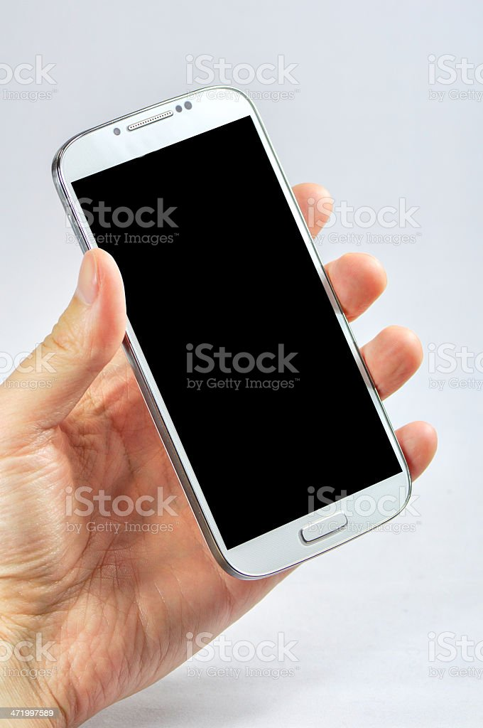 Holding a smart phone with blank screen isolated on white royalty-free stock photo