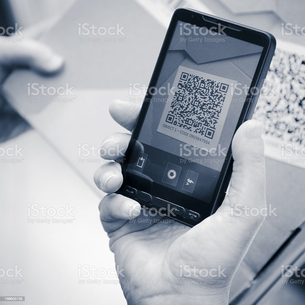 Holding a smartphone photography qr code royalty-free stock photo