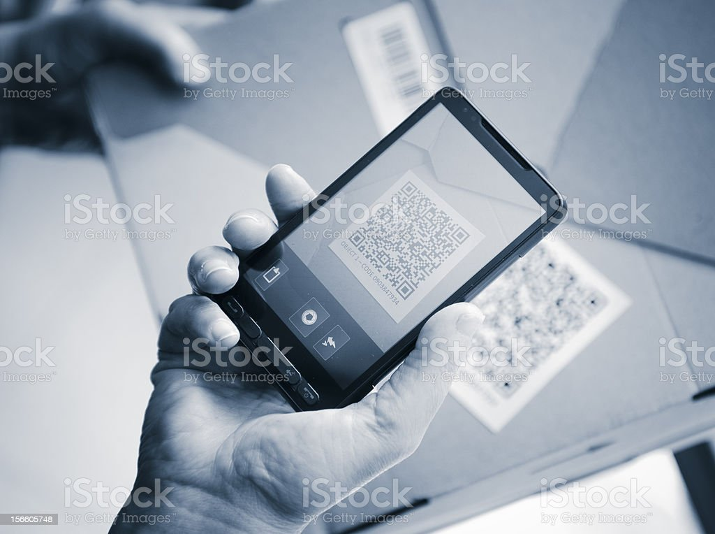 Holding a smartphone photography qr code stock photo
