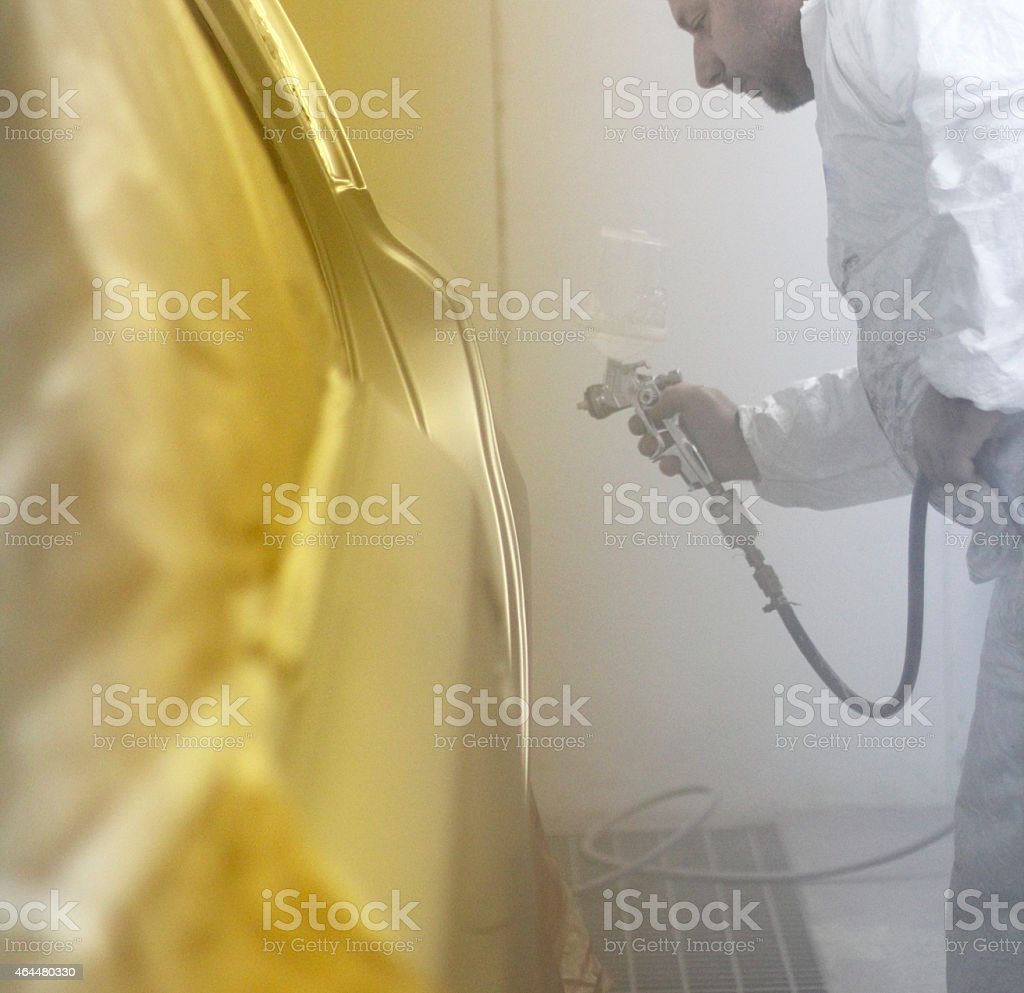 Holding a spray gun stock photo
