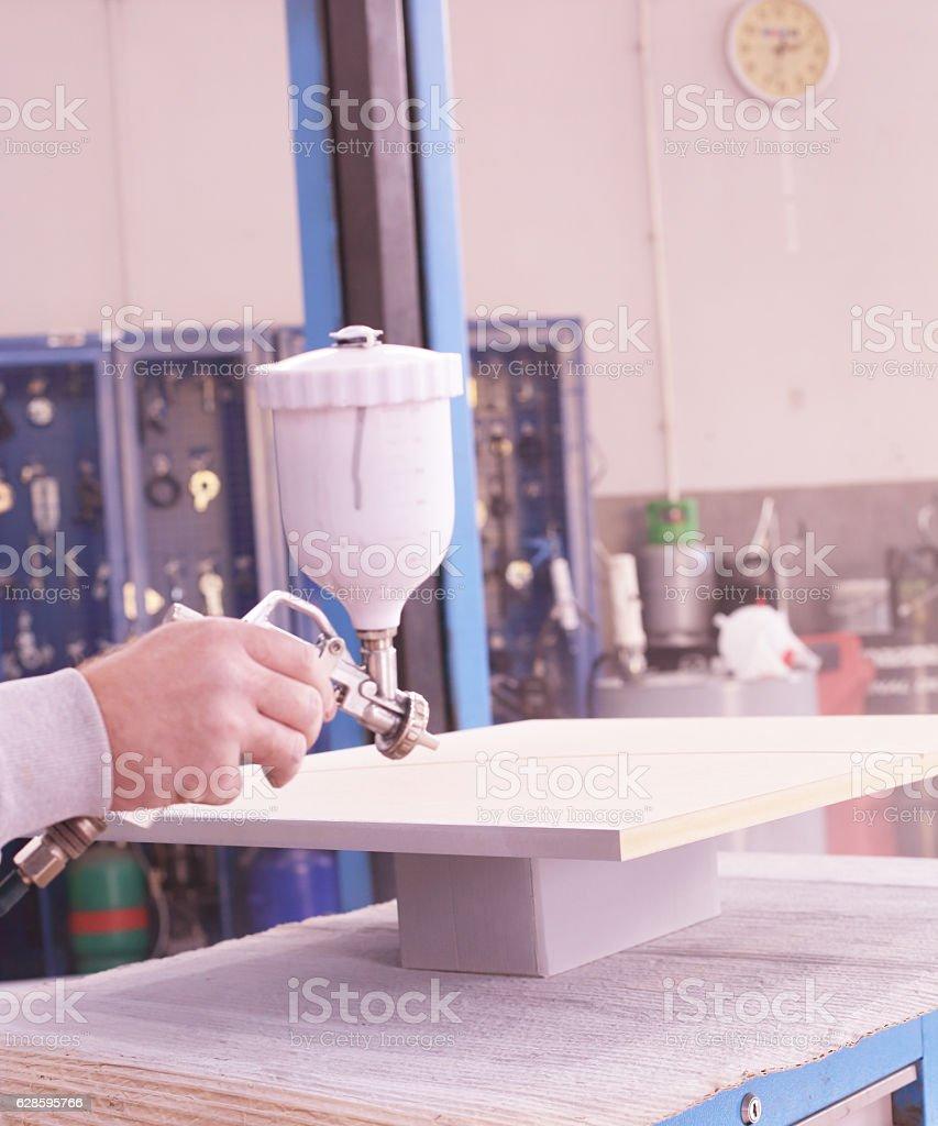 Holding a spray gun stock photo