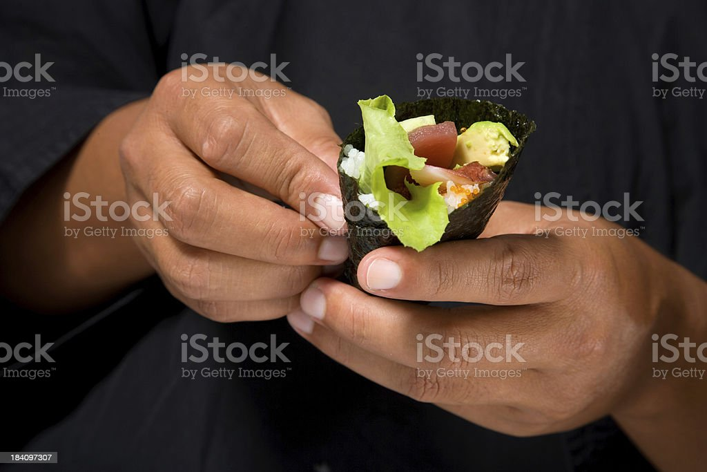 Holding A Sushi Roll royalty-free stock photo