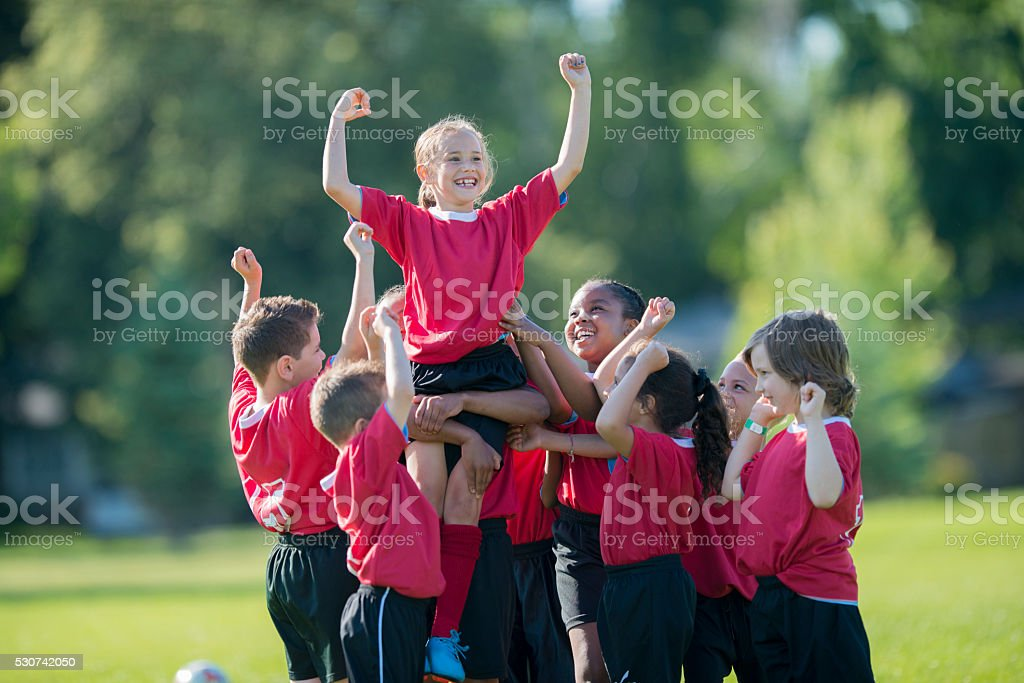Holding a Teammate Up in the Air stock photo